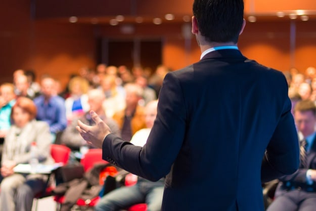 Step 5: Online presentations should factor in interaction with the audience | Online Presentation That Sells | Tips On How to Create One | online presentation | speaker talking to an audience